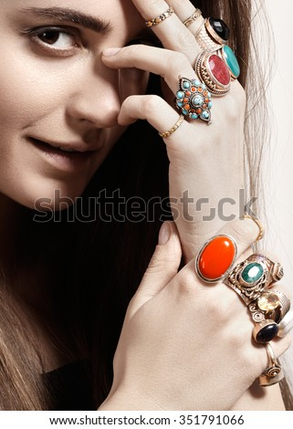 Beautiful model woman with clean skin, perfect hair, natural fashion makeup. Luxurious style with awesome chic jewellery, vintage ring. Romantic boho accessory. Bright vintage rings - stock photo