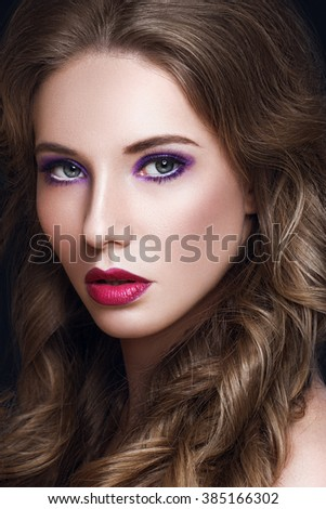 Beautiful Model Woman with Long Curly Brown Hair and Makeup - stock photo