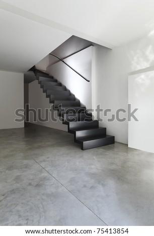 beautiful modern apartment, black staircase - stock photo