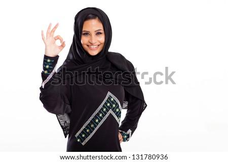 beautiful modern arabian woman giving ok hand sign - stock photo