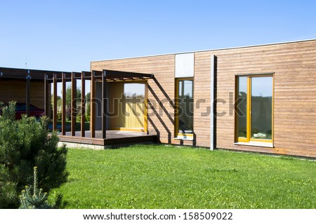 Beautiful modern architecture - low energetic family house from wood - stock photo
