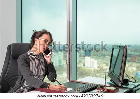 beautiful modern businesswoman inside the office building - stock photo