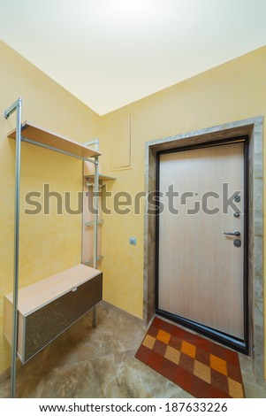 Beautiful modern hallway with entrance door and mat. - stock photo