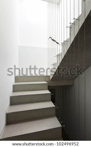 beautiful modern house in cement, interior, staircase - stock photo