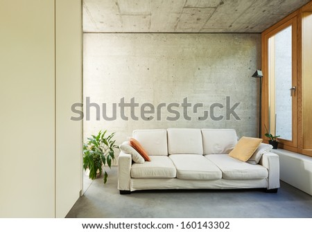 beautiful modern house in cement, interiors, room with divan - stock photo
