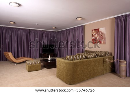 Beautiful modern interior with a convenient armchair from a genuine leather, the big television screen and a beautiful floor vase