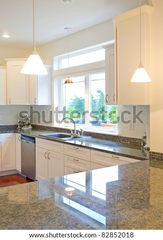 Beautiful Modern Kitchen in New Luxury Home - stock photo