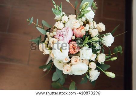 beautiful modern wedding bouquet on wooden planks. - stock photo