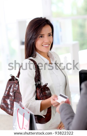 Beautiful modern woman buying with credit card - stock photo