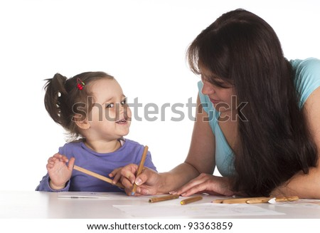 beautiful mom with her child drawing at the table