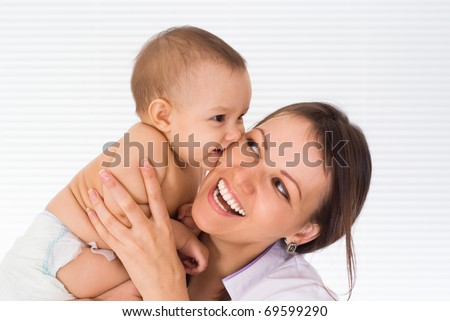 beautiful mom with newborn on a white background - stock photo