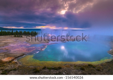 Beautiful Morning in West Thumb Geyser Basin with Yellowstone Lake in the background - stock photo