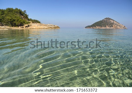 Beautiful morning light reflecting in the mediterranean sea at the island of Thassos, Greece. - stock photo