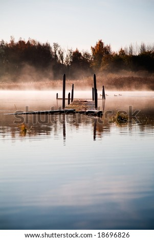 Beautiful morning mist by the lake - stock photo