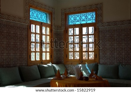 Beautiful Moroccan window with a interior of a palace - stock photo