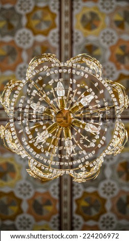 Beautiful mosaic arabesque design on ceiling of a mosque. Mosque ornaments on the walls and chandelier composition - stock photo