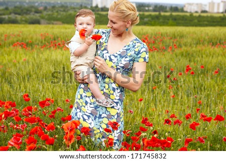 Beautiful Mother And Baby outdoors. Nature. Beauty Mum and her Child playing in Park together. Outdoor Portrait of happy family - stock photo