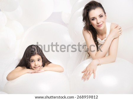 Beautiful mother and  daughter - stock photo