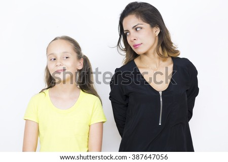 Beautiful Mother and Daughter Worried Together on white background - stock photo