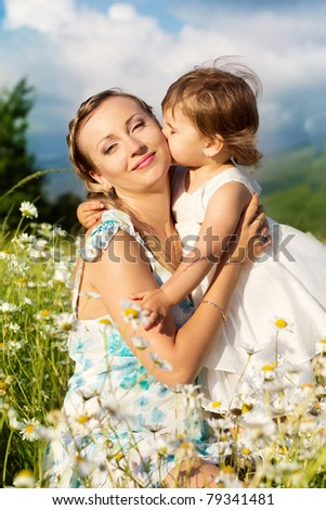 beautiful mother and little daughter