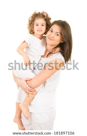 Beautiful mother holding her little girl isolated on white background - stock photo