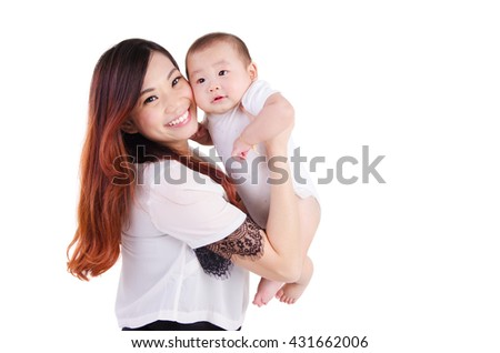 Beautiful mother picking up her six months old baby - stock photo