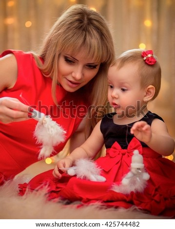 Beautiful mother with baby girl - stock photo