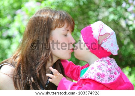 beautiful mother with cute little baby - stock photo