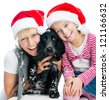 Beautiful mothet and little girl in Santa hats on a white background - stock photo
