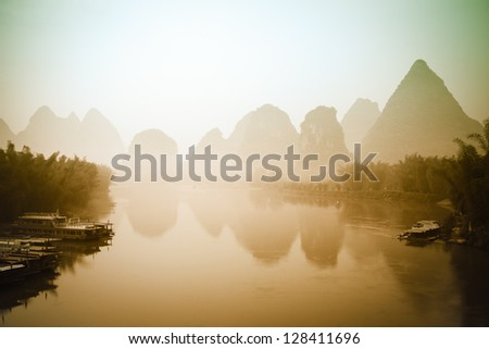 beautiful mountain and waters landscape at sunrise in yangshuo,guilin,China - stock photo