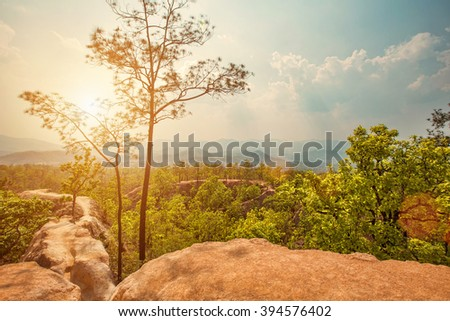 Beautiful mountain canyon with red sand and sunset - stock photo