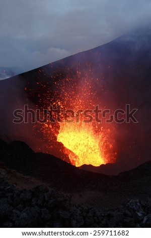Beautiful mountain landscape: eruption volcano - fountain lava from volcano. Russia, Far East, Kamchatka Peninsula - stock photo