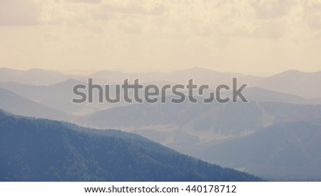 Beautiful mountain landscape. Mountains and hills in the haze - stock photo
