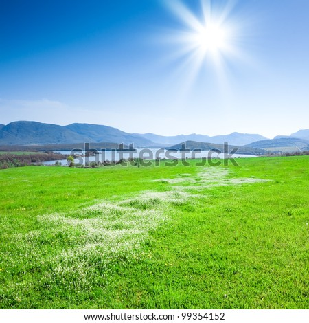 Beautiful mountain landscape with a lake and meadow - stock photo