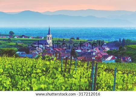 Beautiful mountain landscape with vineyards and old picturesque town in Germany at sunset, Black forest, Kaiserstuhl, Oberrotweil.Travel and wine-making background. - stock photo