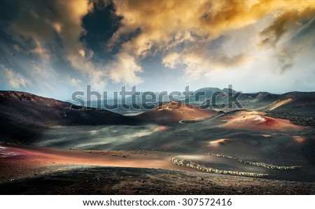 beautiful mountain landscape with volcanoes at sunset in Timanfaya National Park in Lanzarote, Canary Islands - stock photo