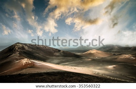beautiful mountain landscape with volcanoes in Timanfaya National Park at sunset in Lanzarote, Canary Islands - stock photo