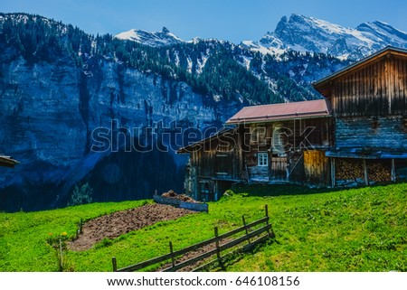 Beautiful mountain landscape with wooden house in Switzerland