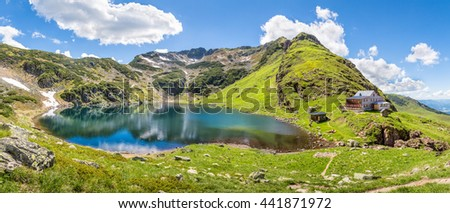 Beautiful mountain panorama with lake and mountain hut in Tyrol, Fieberbrunn, Austria - stock photo