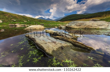 Beautiful mountain scenery, rocks and alpine lake