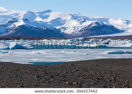 Beautiful mountain show and ice lake in Jokulsarlon, Iceland - stock photo