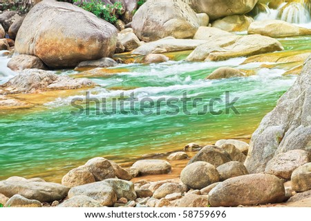 Beautiful mountain stream with rocky sides - stock photo