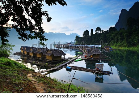 Beautiful mountain surrounded by water, Natural attractions in Ratchapapha dam at Surat Thani province, Guilin of Thailand.  - stock photo