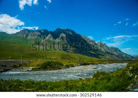 Beautiful mountains in the clouds on the blue sky background,the summer.The Caucasus..Russia.