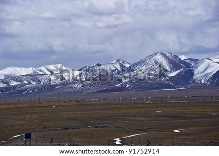 beautiful mountains landscape covered by heavy snow with blue sky and white cloud