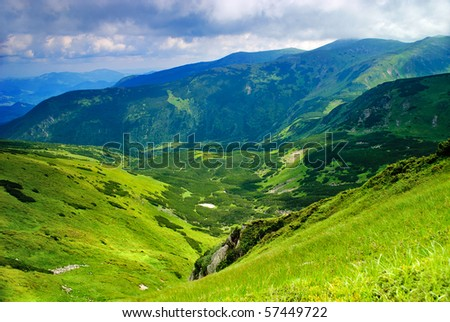 Beautiful mountains landscape with lake and clouds in Carpathian mountains - stock photo