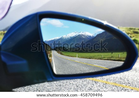 Beautiful mountains seen on the rearview mirror. Haast Pass-Makarora Rd in South Island,New Zealand
