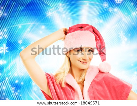 Beautiful mrs. Santa over abstract background