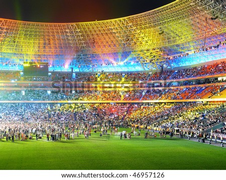 Beautiful multi-coloured arena under beams of projectors - stock photo