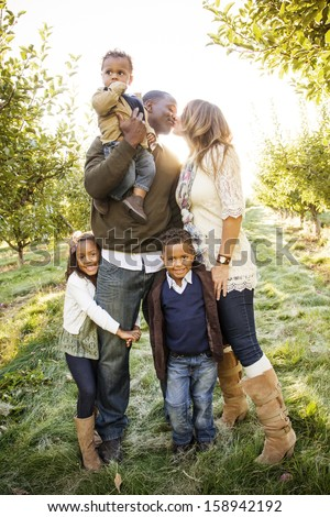 Beautiful Multi Ethnic Family Portrait Outdoors - stock photo